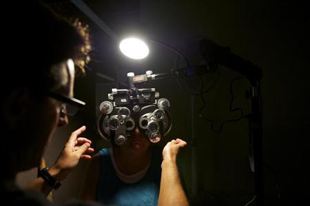 An eye exam is performed at the Remote Area Medical clinic in Wise, Virginia