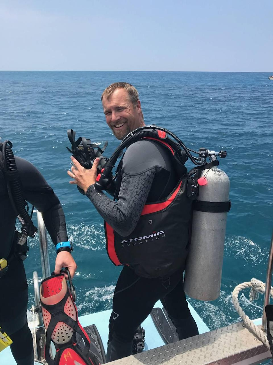 Mike Heithaus, a marine ecologist and dean of FIU's College of Arts, Sciences & Education, is seen on the waters. He was co-author of of a study on sharks and their roles in the ocean.
