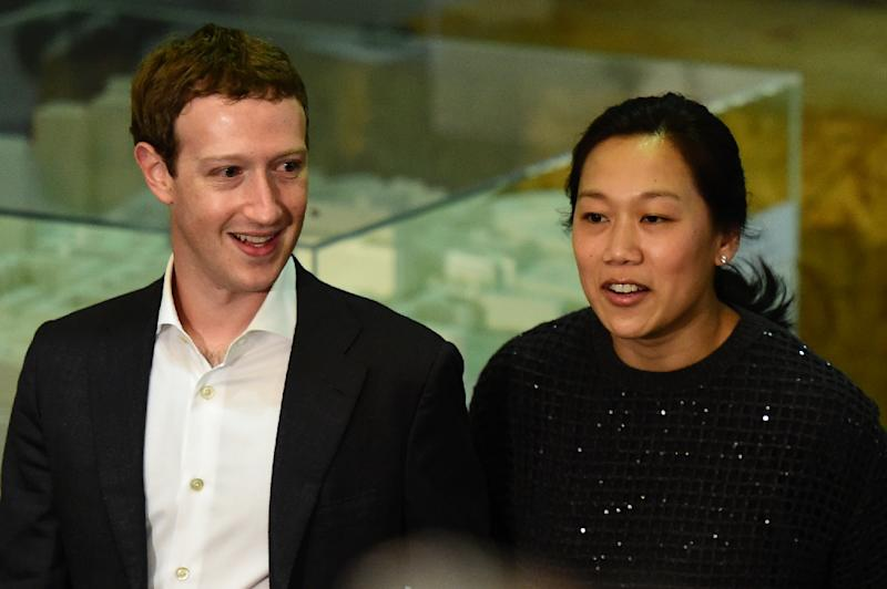 Facebook founder and CEO Mark Zuckerberg (L) and his wife Priscilla Chan pledged $3 billion over the next decade to help banish or manage all disease