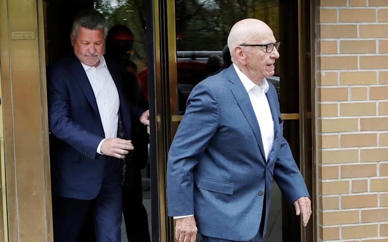 Departing Fox News co-president Bill Shine, left, leaves a New York restaurant with Rupert Murdoch last month - Credit: AP
