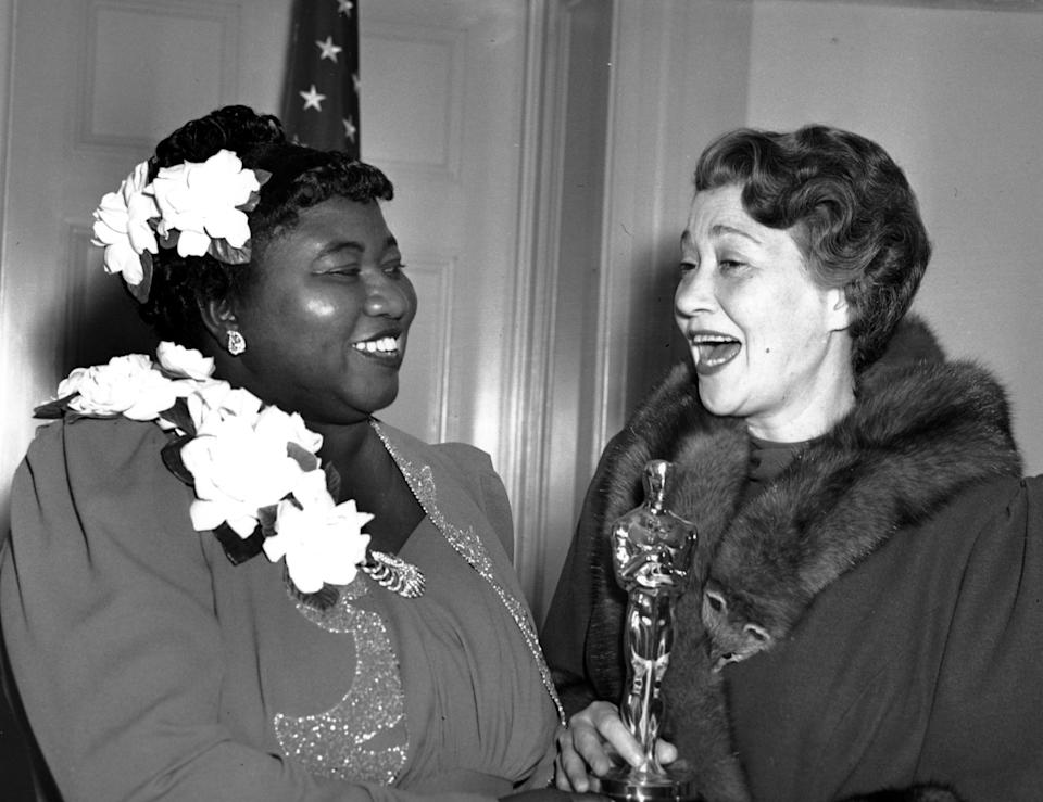 """Hattie McDaniel, left, was given the Motion Picture Academy award for the best performance of an actress in a supporting role in 1939 for her work as """"Mammy"""" in the film version of """"Gone With the Wind""""  on Feb. 29, 1940 in Los Angeles, Calif.  The presentation of the award was given by actress Fay Bainter, right.  (AP Photo)"""