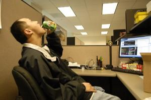 Office worker downing a soda