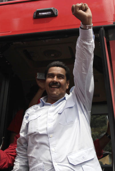 Venezuela's interim President Nicolas Maduro clenches his fist while greeting supporters from his campaign bus in Barinas, Venezuela, Tuesday, April 2, 2013. Late President Hugo Chavez's chosen successor, Nicolas Maduro is competing against opposition leader Henrique Capriles in the April 14 presidential election. (AP Photo/Ariana Cubillos)