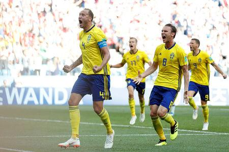 Soccer Football - World Cup - Group F - Sweden vs South Korea - Nizhny Novgorod Stadium, Nizhny Novgorod, Russia - June 18, 2018   Sweden's Andreas Granqvist celebrates with Albin Ekdal after scoring their first goal    REUTERS/Matthew Childs