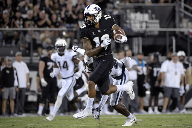 Central Florida wide receiver Gabriel Davis (13) catches a pass in front of Connecticut defensive back Keyshawn Paul for a 73-yard touchdown play during the first half of an NCAA college football game Saturday, Sept. 28, 2019, in Orlando, Fla. (AP Photo/Phelan M. Ebenhack)