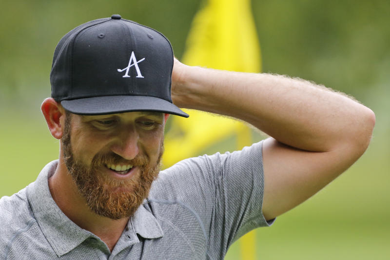 Kevin Chappell smiles after a putt on the ninth hole during the second round of A Military Tribute at The Greenbrier golf tournament in White Sulphur Springs, W.Va., Friday, Sept. 13, 2019. (AP Photo/Steve Helber)