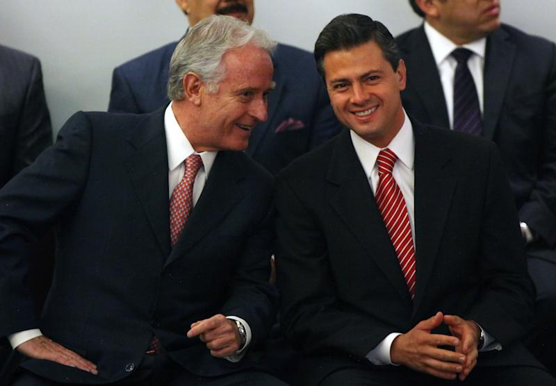 Enrique Pena Nieto, presidential candidate for the Institutional Revolutionary Party, PRI, right, listens to Mexican businessman Alejandro Marti, left, during an event hosted by the non-governmental organization Mexico SOS, that advocates security and justice, in Mexico City, Monday April 2, 2012. The four candidates for Mexico's presidency officially launched their campaigns for the July 1 election on Friday, all of them promising change. (AP Photo/Alexandre Meneghini)