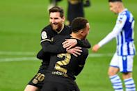 Lionel Messi and Sergino Dest both scored twice in Barcelona's crushing win at Real Sociedad