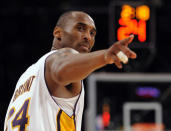 Los Angeles Lakers guard Kobe Bryant (24) points to a player behind him after making a basket in the closing seconds against the Orlando Magic in Game 2 of the NBA basketball finals, in Los Angeles, June 7, 2009. Bryant, the 18-time NBA All-Star who won five championships and became one of the greatest basketball players of his generation during a 20-year career with the Los Angeles Lakers, died in a helicopter crash Sunday, Jan. 26, 2020. (AP Photo/Mark J. Terrill)