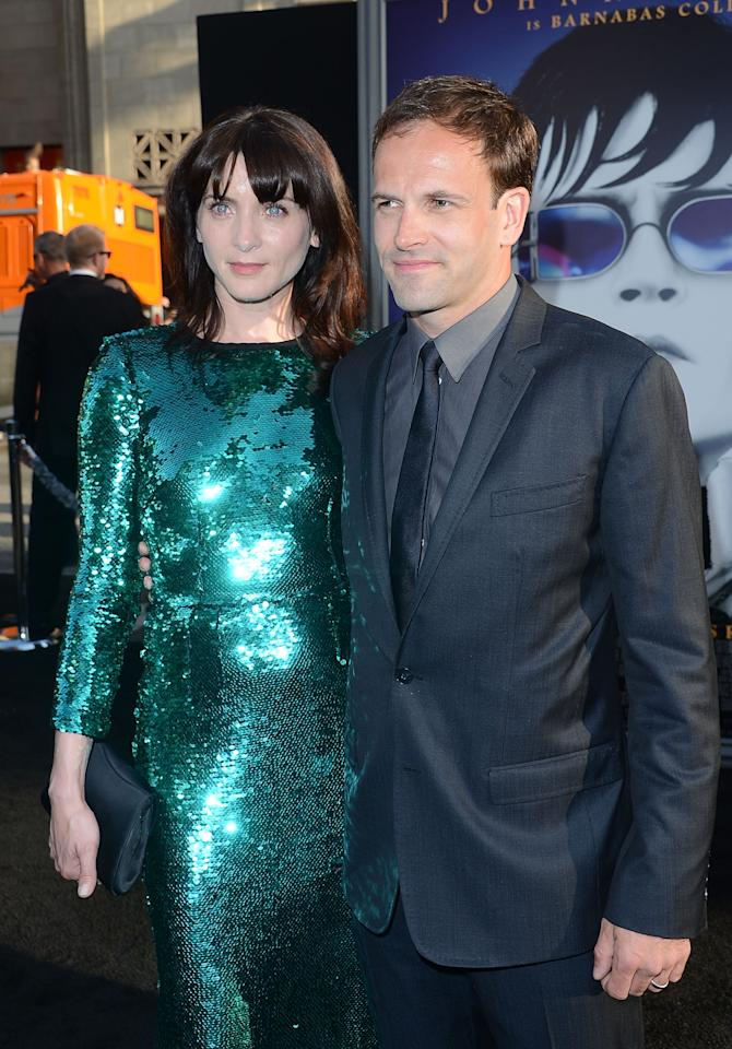 HOLLYWOOD, CA - MAY 07:  Actor Jonny Lee Miller and wife Michele Hicks arrive at the premiere of Warner Bros. Pictures' 'Dark Shadows' at Grauman's Chinese Theatre on May 7, 2012 in Hollywood, California.  (Photo by Jason Merritt/Getty Images)