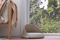 """<p>Never underestimate the aesthetic appeal of a curvy, mid-century inspired cat bed. Composed of molded plywood, this sleek cat bed is designed with a soft corner that your cat can nestle into. """"The open area allows your cat the freedom to come and go easily, and be as observant of the surroundings as they wish,"""" says Cunningham.</p> <p><strong><em>Shop Now:</em></strong><em> Tuft + Paw Beckon Cat Bed, $199, </em><a href=""""https://www.tuftandpaw.com/collections/cat-beds/products/beckon-cat-bed"""" rel=""""nofollow noopener"""" target=""""_blank"""" data-ylk=""""slk:tuftandpaw.com"""" class=""""link rapid-noclick-resp""""><em>tuftandpaw.com</em></a><em>.</em></p>"""