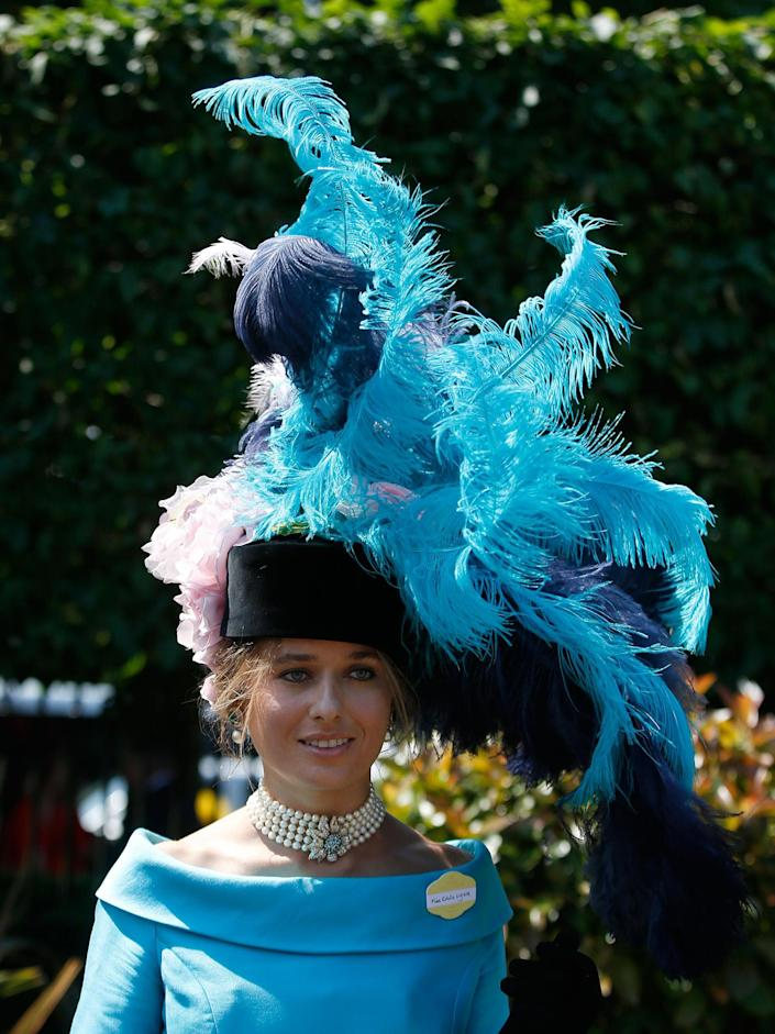 <p>Edita Ligere poses for photographers wearing a large feathered hat on the first day of the Royal Ascot horse race meeting in Ascot, England, Tuesday, June 20, 2017. (AP Photo/Alastair Grant) </p>