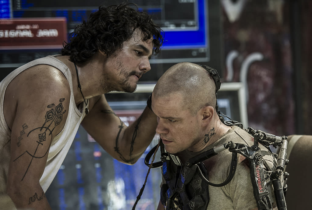 Wagner Moura (left) and Matt Damon in Columbia Pictures' ELYSIUM.