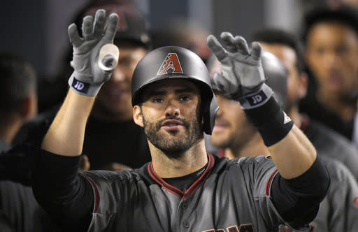 J.D. Martinez gestures toward the camera after hitting his MLB record-tying fourth home run in the Diamondbacks' 13-0 win against the Dodgers. (AP)