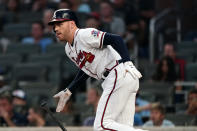 Atlanta Braves first baseman Freddie Freeman (5) drives in a run with a base hit in the first inning of a baseball game against the Colorado Rockies Tuesday, Sept. 14, 2021, in Atlanta. (AP Photo/John Bazemore)