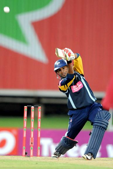 PRETORIA, SOUTH AFRICA - OCTOBER 10: Adil Rashid of Yorkshire hits out during the Karbonn Smart CLT20 pre-tournament Qualifying Stage match between Yorkshire (England) and Trinidad and Tobago (West Indies) at SuperSport Park on October 10, 2012 in Pretoria, South Africa.  (Photo by Lee Warren / Gallo Images / Getty Images)