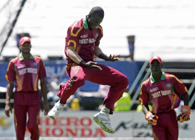 West Indian bowler Sammy celebrates the wicket of Hopes during the ICC Champions Trophy cricket match against Australia in Johannesburg