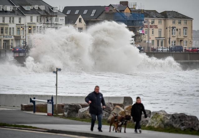 Huge waves hit the sea wall in Porthcawl, Wales, as gales of up to 80mph from Storm Brendan caused disruption around the UK (PA)