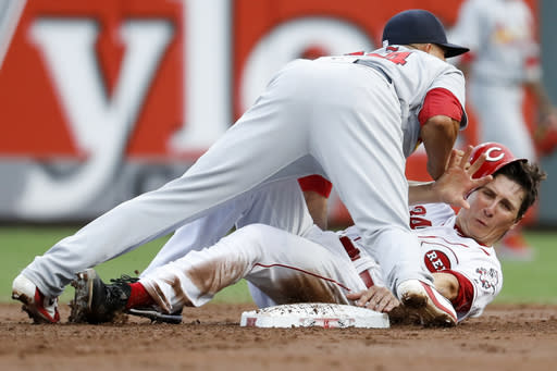 St. Louis Cardinals shortstop Yairo Munoz, front, forces out Cincinnati Reds' Homer Bailey at second during the third inning of a baseball game Tuesday, July 24, 2018, in Cincinnati. Jose Peraza was safe at first. (AP Photo/John Minchillo)