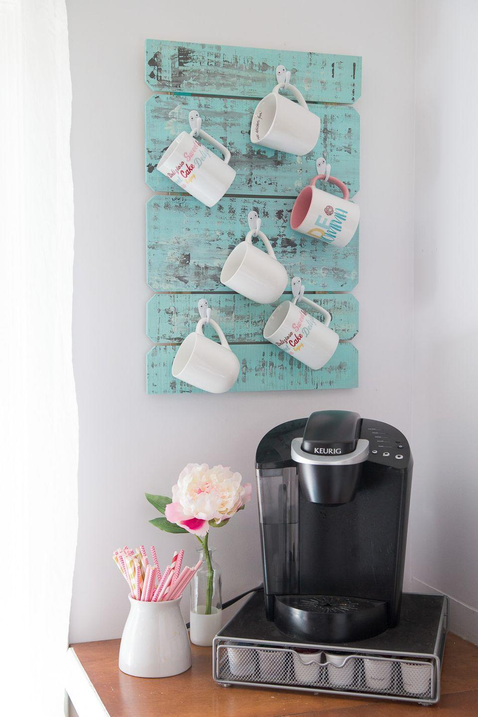 """<p>You could get her yet another mug <em>or</em> you could make this pretty, rustic-inspired mug organizer to hold all of the gifts you've given her throughout the years<br></p><p><a href=""""https://www.madetobeamomma.com/coffee-cup-holder/?crlt.pid=camp.MazQyqmrXEjR"""" rel=""""nofollow noopener"""" target=""""_blank"""" data-ylk=""""slk:Get the tutorial at Made to Be a Momma »"""" class=""""link rapid-noclick-resp""""><em>Get the tutorial at Made to Be a Momma »</em></a> </p>"""