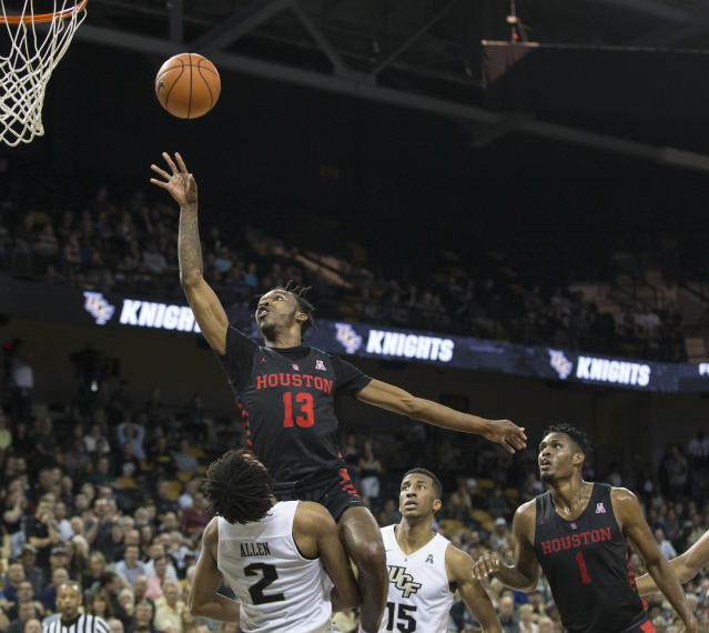 Houston guard Dejon Jarreau (13) shoots over Central Florida's guard Terrell Allen (2) during the first half of an NCAA college basketball game in Orlando, Fla., Thursday, Feb. 7, 2019. (AP Photo/Willie J. Allen Jr.)