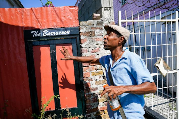Sékou Luke, who helps with the Antigua and Barbuda Reparations Support Commission, shows visitors a barracoon, a cottage that was used to hold enslaved Africans before they were marched down Parade Street to an auction spot a few blocks away. The cottage, which is currently vacant, was more recently an art studio.