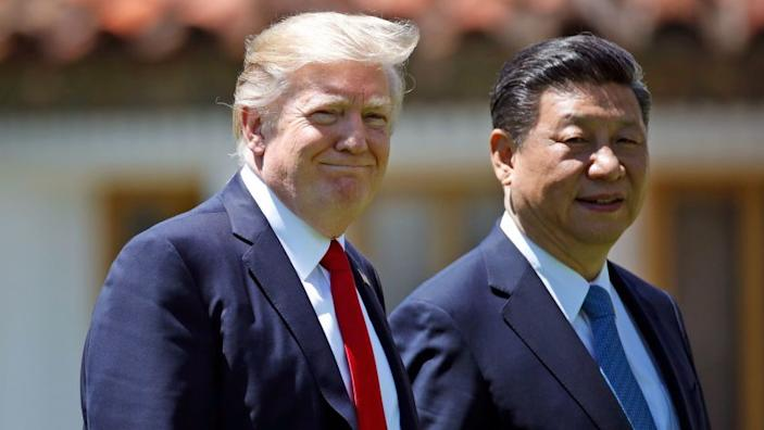 """President Trump has long boasted of his friendship with Chinese President Xi Jinping. Above, they walk together after meetings at Trump's Mar-a-Lago resort in Palm Beach, Fla. <span class=""""copyright"""">(Alex Brandon / Associated Press)</span>"""