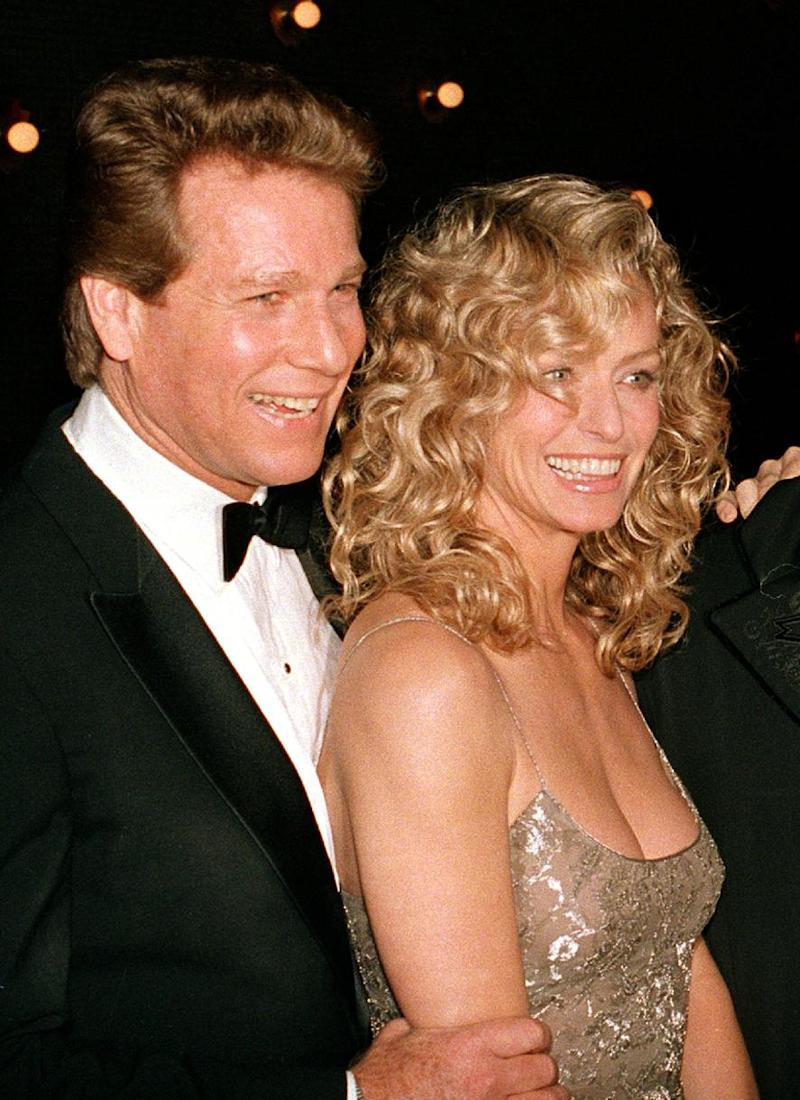 "FILE - This March 5, 1989 file photo shows actors Ryan O'Neal, left, and Farrah Fawcett at the premiere of the film. ""Chances Are,"" in New York. O'Neal testified in a Los Angeles courtroom on Monday, Dec. 2, 2013, about his relationship with Fawcett and his claimed ownership of an Andy Warhol portrait of the actress. The Oscar-nominated actor is being sued by the University of Texas at Austin, which is seeking to gain possession of the portrait which it claims the actress bequeathed to the university. (AP Photo/Ray Stubblebine, file)"