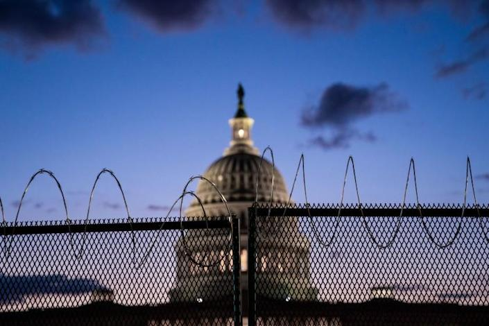 WASHINGTON, DC - MARCH 04: The U.S. Capitol Building, which saw boosted security, Thursday, after officials warned of an attack plot by extremists, two months after supporters of former president Donald Trump stormed the Capitol building is illuminated with the setting sun as the Senate debates the coronavirus relief package on Thursday, March 4, 2021 in Washington, DC. (Kent Nishimura / Los Angeles Times)