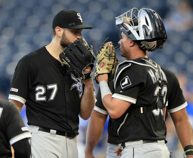 Chicago White Sox starting pitcher Lucas Giolito (27) talks with catcher James McCann (33) after a run scored in the fourth inning of a baseball game against the Kansas City Royals at Kauffman Stadium in Kansas City, Mo., Monday, July 15, 2019. (AP Photo/Orlin Wagner)