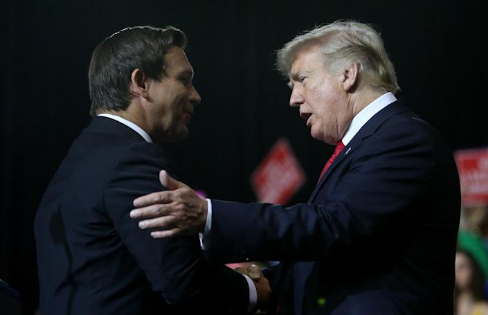 President Trump greets Ron DeSantis during a rally at the Florida State Fairgrounds in Tampa on Tuesday. (Photo: ©James Borchuck/Tampa Bay Times via ZUMA Wire)