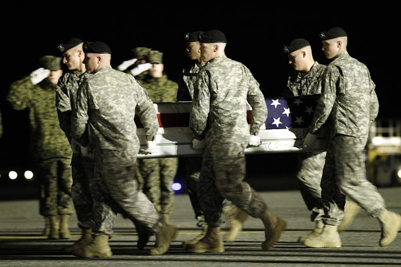 An Army carry team carries the transfer case containing the remains of Army Pfc. Shane M. Reifert of Cottrellville, Mich. upon  arrival at Dover Air Force Base, Del. on Monday, Nov. 8, 2010. The Department of Defense announced the death of Army Pfc. Shane M. Reifert who was supporting Operation Enduring Freedom in Afghanistan.(AP Photo/Jose Luis Magana)
