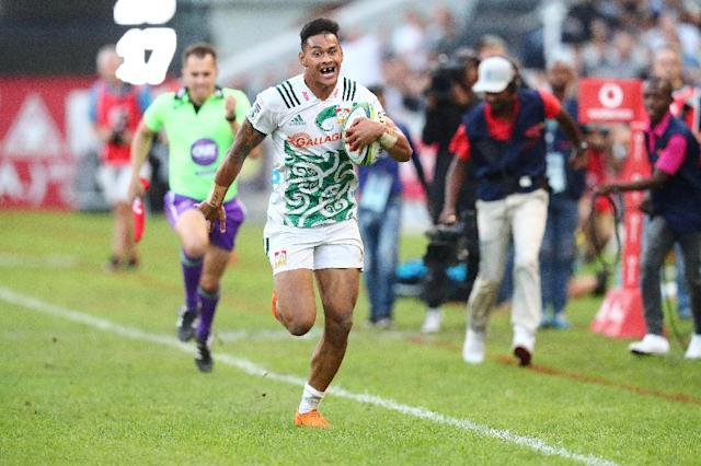 Catch me if you can: Chiefs winger Solomona Alaimalo runs to the try line in the Super Rugby match against the Sharks (AFP Photo/ANESH DEBIKY)