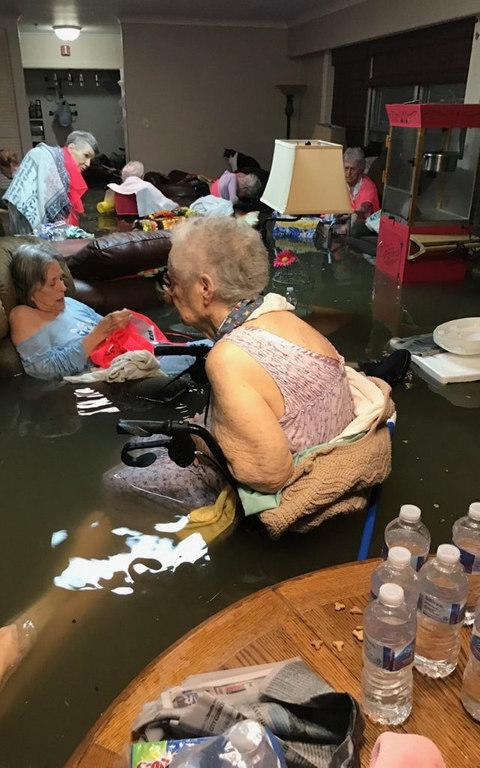 Residents at La Vita Bella nursing home in Dickinson Texas sit in flood waters as they wait to be rescued - Credit: @DivendsMGR