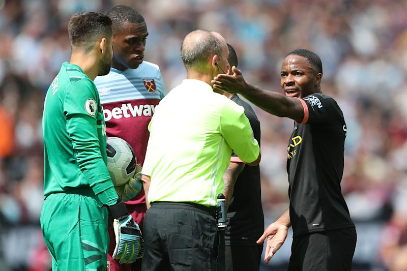 LONDON, ENGLAND - AUGUST 10: Raheem Sterling of Man City argues with referee Mike Dean after their 3rd goal is disallowed by VAR during the Premier League match between West Ham United and Manchester City at London Stadium on August 10, 2019 in London, United Kingdom. (Photo by Charlotte Wilson/Offside/Offside via Getty Images)