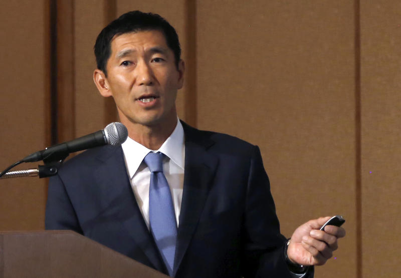 Yuji Sugimoto, the Japan head of Bain Capital, speaks during a press conference in Tokyo, Thursday, Oct. 5, 2017. The investment fund heading the consortium buying the memory chip business of Toshiba Corp. said Thursday it will try to reach a speedy settlement with Western Digital, the U.S. joint venture partner of Toshiba that is opposing the sale.(AP Photo/Yuri Kageyama)