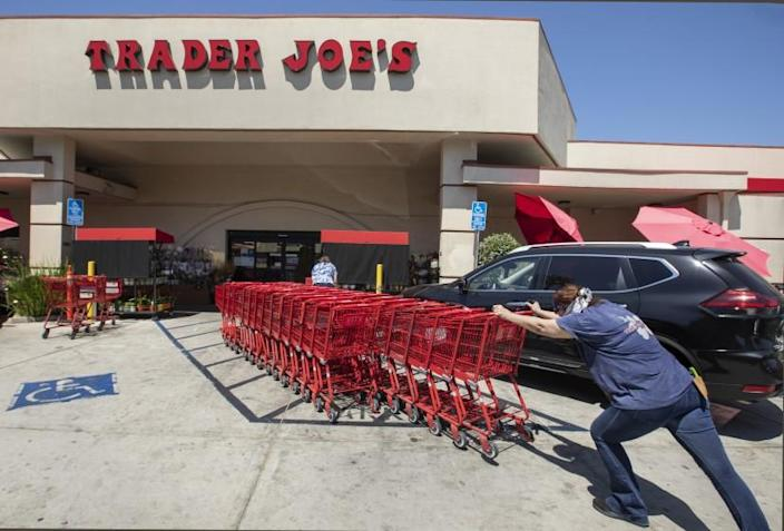 SHERMAN OAKS, CA -JULY 20, 2020: Shopping carts are returned to a collection area outside of Trader Joe's on Riverside Dr. In Sherman Oaks. Trader Joe's has responded to criticisms about its packaging by announcing that it is in the process of eliminating labels that use ethnic-sounding names intended to be humorous. The offending products bear such labels as Trader Ming's for foods and condiments related to Chinese cuisine, Trader Jose's for Mexican-style products and Trader Giotto's for Italian-themed items. (Mel Melcon / Los Angeles Times)
