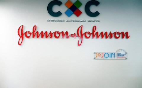 logo of US multinational medical devices and pharmaceutical company Johnson & Johnson  - Credit: CHARLY TRIBALLEAU/AFP