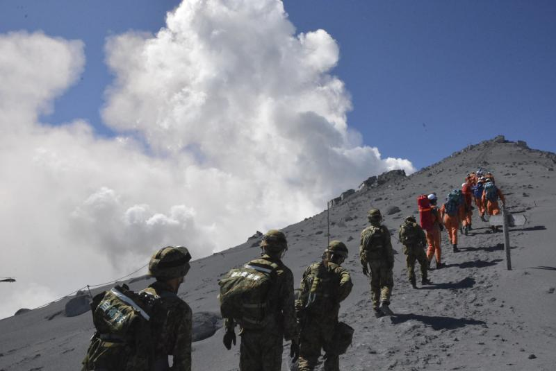 SDF soldiers and firefighters climb up Mt. Ontake, which straddles Nagano and Gifu prefectures, for a rescue operation
