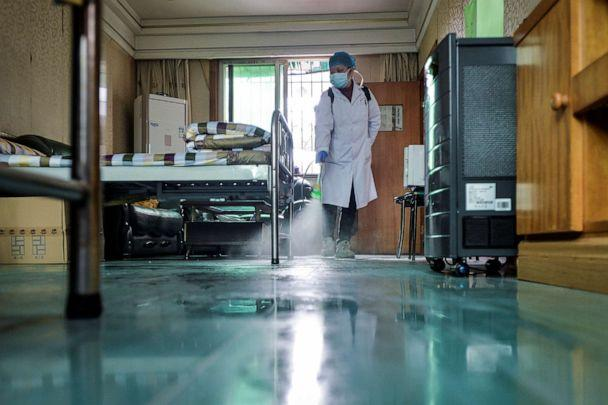 PHOTO: A doctor disinfects a room for medical staff with sanitizing equipment at a community health service center in the Qingshan district of Wuhan, Hubei province, China, Feb. 10, 2020. (China Daily/Reuters)