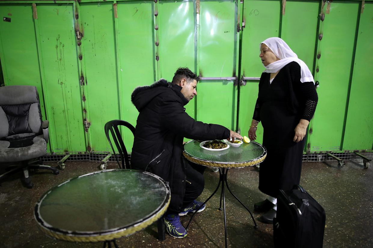 A Druze woman sells traditional food at a makeshift stall at the Central Bus Station on Feb. 3. (Photo: Corinna Kern/Reuters)