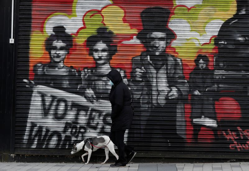 A person walks their dog ahead of tomorrow's local elections, in Hartlepool