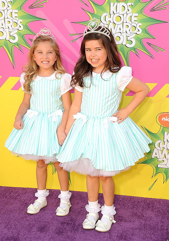 Ellen DeGeneres' adorable British correspondents Rosie McClelland (left) and her cousin Sophia Grace Brownlee arrived in matching striped dressses, white shoes, and tiaras. Too cute!