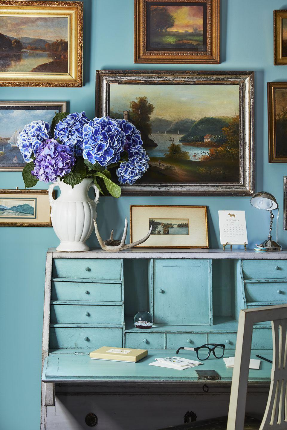 <p><strong>Paint Color: </strong>Madison Avenue by Benjamin Moore</p><p>Sheila Bridge's office nook is painted in a cheerful shade of teal that is sure to spark creativity. </p>