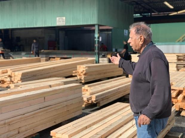 Tom Sundher of Sundher Timber Products is unsure how to proceed with his business dealings in China.  (Tanya Fletcher/CBC - image credit)