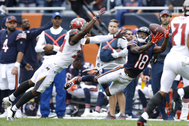 <p>Taylor Gabriel #18 of the Chicago Bears receives the pass in the second quarter against the Tampa Bay Buccaneers at Soldier Field on September 30, 2018 in Chicago, Illinois. (Photo by Joe Robbins/Getty Images) </p>