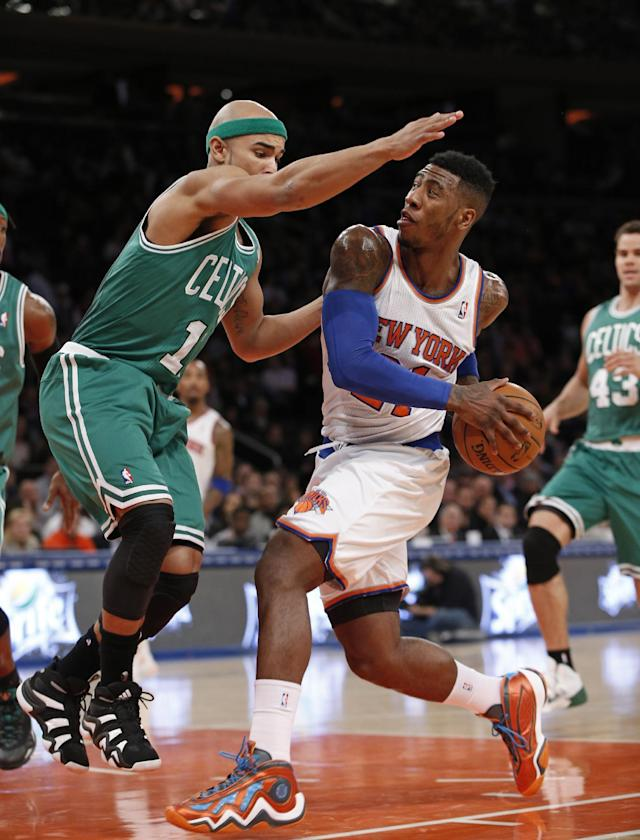 Boston Celtics guard Jerryd Bayless (11) defends New York Knicks guard Iman Shumpert (21) in the first half of an NBA basketball game at Madison Square Garden in New York, Tuesday, Jan. 28, 2014. (AP Photo/Kathy Willens)