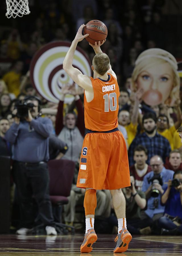 Boston College fans attempt to distract Syracuse guard Trevor Cooney (10) as he shoots a free-throw during the first half of an NCAA college basketball game in Boston, Monday, Jan. 13, 2014. (AP Photo/Stephan Savoia)