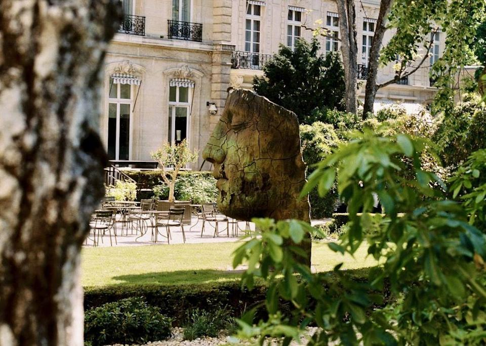 """<p><a href=""""https://restaurant-apicius.com"""" rel=""""nofollow noopener"""" target=""""_blank"""" data-ylk=""""slk:Apicius"""" class=""""link rapid-noclick-resp"""">Apicius</a> is fine dining at its most opulent, yet without the formality that sometimes makes such indoor multi-course feasts a bit oppressive. The key is its masterful new garden design—which manages to at once create private, intimate nooks in what is, in fact, a very large and grand space. (In this photo, it's not yet set up for dinner, but trust us—it's magical.) One can easily imagine a scene from <em><a href=""""https://www.townandcountrymag.com/leisure/arts-and-culture/a34978323/bridgerton-season-2/#:~:text=Season%202%20is%20currently%20filming.&text=The%20incomparable%20cast%20of%20Bridgerton,to%20dominate%20the%20social%20season.%22"""" rel=""""nofollow noopener"""" target=""""_blank"""" data-ylk=""""slk:Bridgerton"""" class=""""link rapid-noclick-resp"""">Bridgerton</a></em> being filmed here—maybe a stolen kiss behind an orange blossom tree. Michelin-starred, and under the helm of brilliant chef Mathieu Pacaud, Apicius is housed in a small, tucked-away, 1860 urban château at 20, Rue D'Artois, off the Champs-Elysées. Try the langoustines, and don't forget to order the chocolate soufflé at the start of the meal, so it's ready when you are.</p>"""