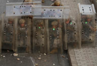 """Lebanese soldiers hide from stones behind protective shields as they clash with supporters of Prime Minister-designate Saad Hariri in Beirut, Lebanon, on Thursday, July 15, 2021. Hariri says he is stepping down, nine months after he was named to the post by the parliament, citing """"key differences"""" with the country's president, Michel Aoun. (AP Photo/Hussein Malla)"""